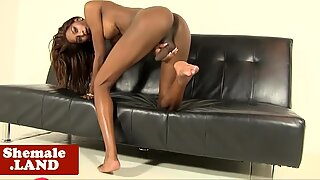 Ebony trans goddess wanks chocolate cock solo