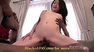 Japanese woman taking on two black cocks